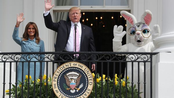 U.S. President Donald Trump and first lady Melania Trump wave beside a person in an Easter Bunny costume on the Truman balcony of the White House during the 2019 White House Easter Egg Roll in Washington, U.S., April 22, 2019 - Sputnik International