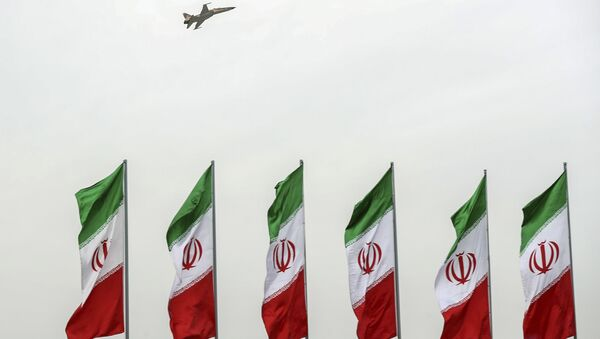 In this photo released by the official website of the office of the Iranian Presidency, a fighter jet flies over Iranian flags during the army parade commemorating National Army Day in front of the shrine of the late revolutionary founder Ayatollah Khomeini, just outside Tehran, Iran, Thursday, April 18, 2019 - Sputnik International