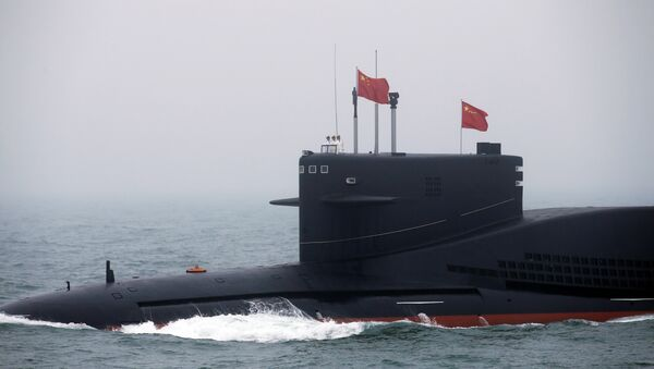 Chinese Navy's nuclear-powered submarine Long March 11 takes part in a naval parade off the eastern port city of Qingdao, to mark the 70th anniversary of the founding of Chinese People's Liberation Army Navy - Sputnik International