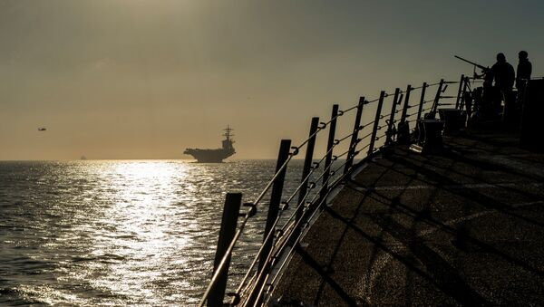 Sailors stand watch on the brow of the Arleigh Burke-class guided-missile destroyer USS Bainbridge while the ship follows the Nimitz-class aircraft carrier USS Abraham Lincoln into the Strait of Gibraltar in the Atlantic Ocean, April 13, 2019. Picture taken on April 13, 2019 - Sputnik International