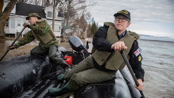 Royal Canadian Navy and Royal Canadian Engineers personnel patrol an area of flooding to look for those in need of help or evacuation in Maskinonge, south of Trois-Rivieres, Quebec, Canada. File photo - Sputnik International