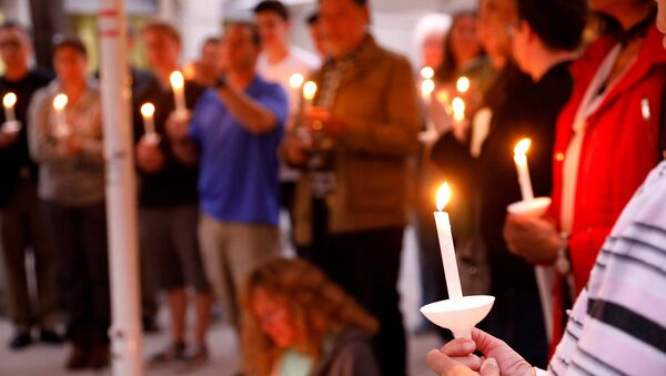 A candlelight vigil is held at Rancho Bernardo Community Presbyterian Church for victims of a shooting incident at the Congregation Chabad synagogue in Poway, north of San Diego, California, U.S. April 27, 2019 - Sputnik International