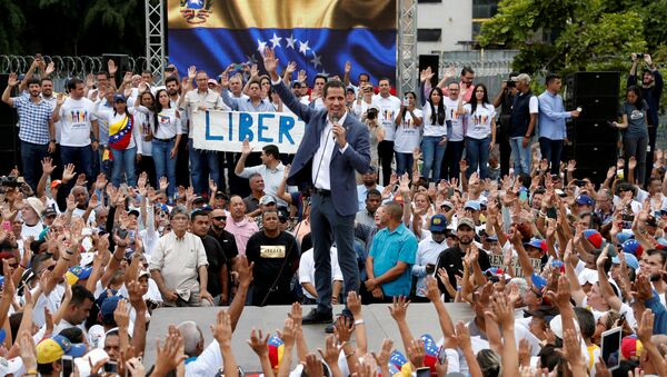Venezuelan opposition leader Juan Guaido, who many nations have recognised as the country's rightful interim ruler, speaks during a swearing-in ceremony for supporters in Caracas, Venezuela April 27, 2019 - Sputnik International