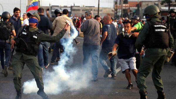 A military member throws a tear gas canister near the Generalisimo Francisco de Miranda Airbase La Carlota, in Caracas, Venezuela April 30, 2019 - Sputnik International