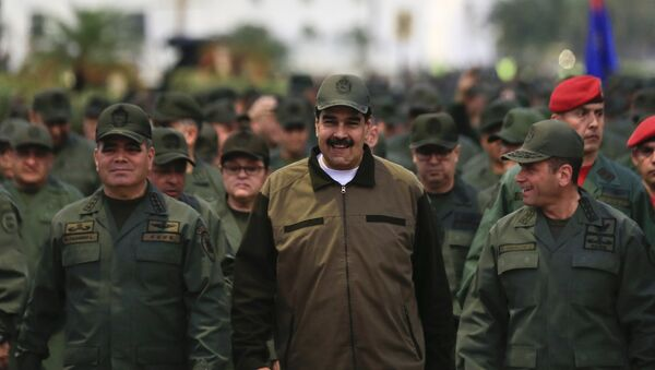 In this handout photo released by Miraflores Press Office, Venezuela's President Nicolas Maduro, center, accompanied by Defense Minister Gen. Vladimir Padrino Lopez, left, and the Strategies Operations Commander, Adm. Remigio Ceballos, arrive for a meeting with the troops at Fort Tiuna in Caracas, Venezuela, Thursday, May 2, 2019 - Sputnik International