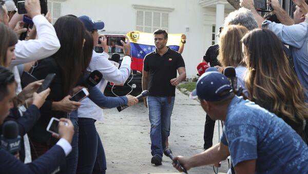 Venezuelan opposition leader Leopoldo Lopez walks to gate of the Spanish ambassador's residence in Caracas to speak with the press, in Venezuela, Thursday, May 2, 2019 - Sputnik International