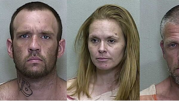 Brandon Hayley, Mary Durham and Lucian Evans appear in mugshots taken at the Marion County Jail in 2019. - Sputnik International