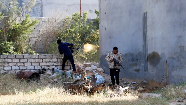 A member of the Libyan internationally-recognized government forces fires during a fight with Eastern forces in Ain Zara, Tripoli, Libya April 28, 2019 - Sputnik International