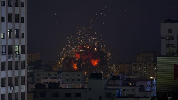 An explosion caused by an Israeli airstrike on a building in Gaza City, Saturday, May 4, 2019 - Sputnik International