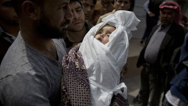 A relative of a Palestinian, 14-month-old, Seba Abu Arar, carry her body out of the Shifa hospital morgue before her funeral in Gaza City, Sunday, May. 5, 2019. Gaza's Health Ministry said the Palestinian infant was killed when Israeli aircraft hit near her house - Sputnik International