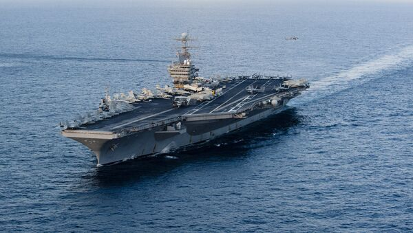 This January 19, 2012 image provided by the US Navy, shows the Nimitz-class aircraft carrier USS Abraham Lincoln (CVN 72) transiting the Arabian Sea. - Sputnik International