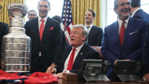 U.S. President Donald Trump shares a moment with left wing and MVP Alexander Ovechkin of the Washington Capitals, defenseman John Carlson, and team owner Ted Leonsis during an Oval Office event at the White House March 25, 2019 in Washington, DC - Sputnik International