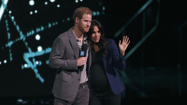 Meghan, the Duchess of Sussex, is brought on stage by Britain's Prince Harry during his speech at WE Day UK, a global initiative to encourage young people to take part in positive social change at the SSE Arena in Wembley, London, Wednesday, March 6, 2019 - Sputnik International
