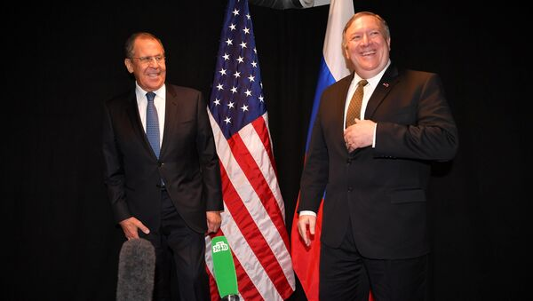 U.S. Secretary of State Mike Pompeo and Russia's Foreign Minister Sergei Lavrov pose for the press as they meet on the sidelines of the Arctic Council Ministerial Meeting in Rovaniemi, Finland May 6, 2019 - Sputnik International