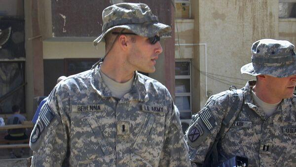 Sept. 21, 2008, file photo, 1st Lt. Michael C. Behenna, left, and his defense attorney Capt. Tom Clark, right, walk in Camp Speicher, a large U.S. base near Tikrit, north of Baghdad, Iraq - Sputnik International