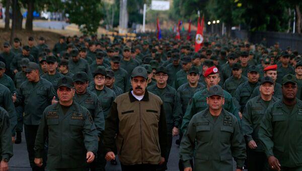 Venezuela's President Nicolas Maduro walks next to Venezuela's Defense Minister Vladimir Padrino Lopez and Remigio Ceballos, Strategic Operational Commander of the Bolivarian National Armed Forces - Sputnik International