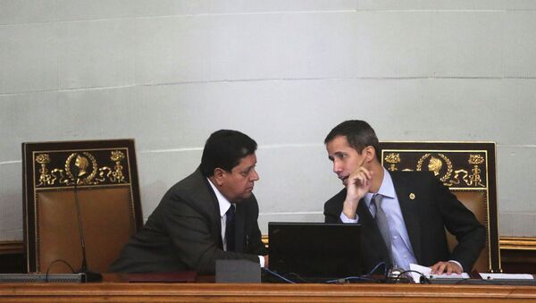Venezuelan opposition leader Juan Guaido, who many nations have recognised as the country's rightful interim ruler, talks to Edgar Zambrano, the assembly vice president, in a session of the National Assembly in Caracas, Venezuela March 6, 2019. Picture taken March 6, 2019. REUTERS/Ivan Alvarado - Sputnik International