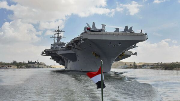 The USS Abraham Lincoln sails south in the Suez canal near Ismailia, Thursday, May 9, 2019 - Sputnik International
