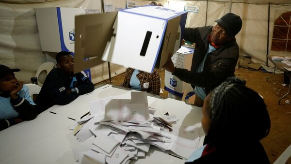 FILE PHOTO: An election official empties a ballot box as counting begins after polls closed in Alexandra township in Johannesburg, South Africa, May 8,2019. REUTERS/Mike Hutchings - Sputnik International