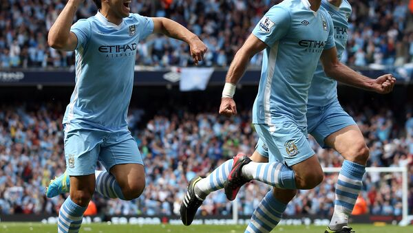 Pablo Zabaleta celebrates with Manchester City team-mates after scoring in the final game of the Premier League season in 2012 - Sputnik International