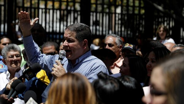 Luis Florido, lawmaker of the Venezuelan coalition of opposition parties (MUD), speaks during a gathering with opposition supporters in Caracas, Venezuela March 17, 2018. REUTERS/Marco Bello/File Photo - Sputnik International