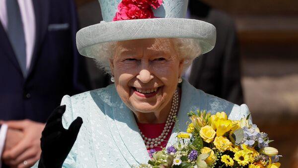 Britain's Queen Elizabeth waves to the public as she leaves the Easter Mattins Service at St George's Chapel at Windsor Castle, Britain April 21, 2019. - Sputnik International