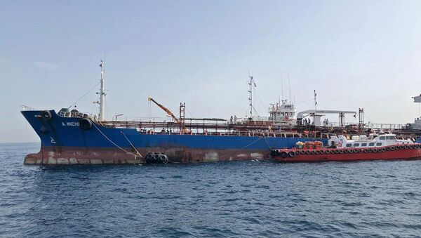 A picture taken on May 13, 2019 off the coast of the Gulf emirate of Fujairah shows the A. Michel tanker under the flag of the United Arab Emirates, one of the four tankers damaged in alleged sabotage attacks in the Gulf the previous day. - Sputnik International