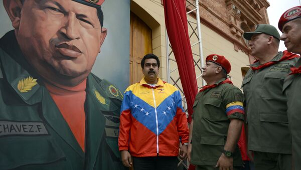 (L to R) Venezuelan Vice President Nicolas Maduro, the president of the National Assembly, Diosdado Cabello and Venezuelan Minister of Defense Diego Molero Bellavia, stand next to a huge portrait of Venezuelan President Hugo Chavez during the conmemoration of the 1992 failed coup led by Chavez, who was an army lieutenant colonel, against then president Carlos Andres Perez, in Caracas, on February 4, 2013 - Sputnik International