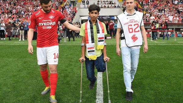 Iraqi boy Qassem Qadim, Hero of Award-Winning Photo of Stenin Contest - Sputnik International
