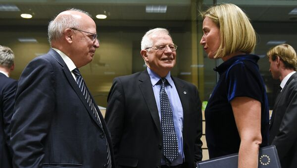Portuguese Foreign Minister Augusto Santos Silva (L) speaks with Spanish Foreign Minister Josep Borrell (C) speak with EU's High Representative for Foreign Affairs and Security Policy Federica Mogherini during a EU Foreign Affairs Council meeting at the EU headquarters in Brussels on May 13, 2019. - Sputnik International