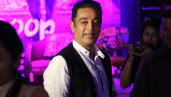 Indian Bollywood actor and director Kamal Haasan waits for a press conference about his latest movie Vishwaroop as part of the three-day long International Indian Film Academy (IIFA) awards Friday June 8, 2012 in Singapore - Sputnik International