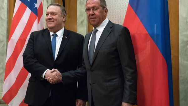 U.S. Secretary of State Mike Pompeo and Russian Foreign Minister Sergey Lavrov shake hands as they pose for a photo prior to their talks in the Black Sea resort city of Sochi, Russia, May 14, 2019 - Sputnik International