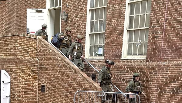 Police are seen walking out of a door at the Venezuelan embassy in Washington D.C., U.S. May 16, 2019 in this picture obtained from social media - Sputnik International