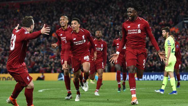 Divock Origi (far right) celebrates his winning goal against Barcelona with Liverpool team-mates - Sputnik International