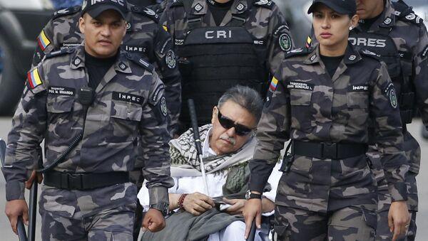 Prison guards escort former rebel leader Seuxis Hernandez outside La Picota jail in Bogota, Colombia, Friday, May 17, 2019 - Sputnik International