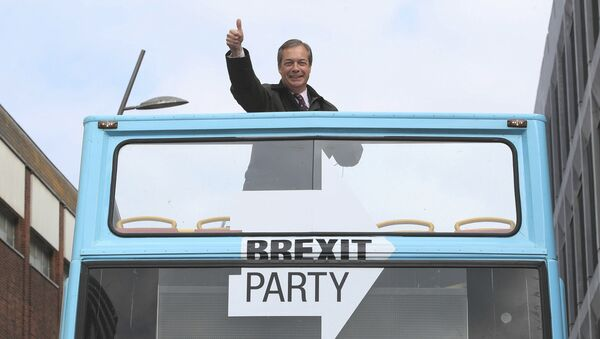 Brexit Party leader Nigel Farage gestures on an open topped bus while on the European Election campaign trail in Sunderland, England, Saturday, May 11, 2019 - Sputnik International