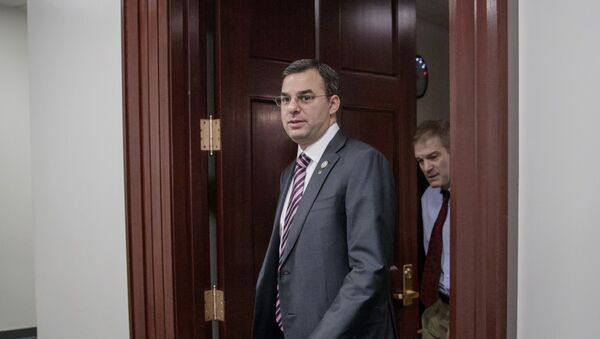 File-This March 28, 2017, file photo shows Rep. Justin Amash, R-Mich., followed by Rep. Jim Jordan, R-Ohio, leaving a closed-door strategy session with Speaker of the House Paul Ryan, R-Wis. A top aide to President Donald Trump is urging the primary defeat of a conservative House member from Michigan. A tweet Saturday, April 1, 2017, by White House social media director Dan Scavino Jr., comes two days after Trump threatened conservative lawmakers who thwarted a House vote on health care legislation. Scavino targeted Amash, a member of the conservative Freedom Caucus criticized by Trump. - Sputnik International