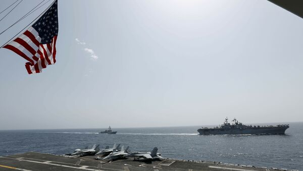 In this Friday, May 17, 2019, photo, released by the U.S. Navy, the amphibious assault ship USS Kearsarge, right, and the Arleigh Burke-class guided-missile destroyer USS Bainbridge, left, are seen from the Nimitz-class aircraft carrier USS Abraham Lincoln as they sail in the Arabian Sea - Sputnik International