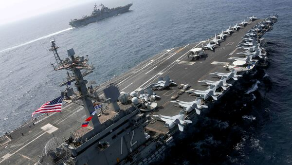 The Nimitz-class aircraft carrier USS Abraham Lincoln (CVN 72) and the Wasp-class Amphibious Assault Ship USS Kearsarge (LHD 3) sail alongside, as the Abraham Lincoln Carrier Strike Group (ABECSG) and Kearsarge Amphibious Ready Group (KSGARG) conduct joint operations, in the U.S. 5th Fleet area of operations in the Arabian Sea, May 17, 2019 - Sputnik International