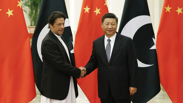 China's President Xi Jinping, right, meets Pakistan's Prime Minister Imran Khan at the Great Hall of the People in Beijing, Friday, Nov. 2, 2018 - Sputnik International