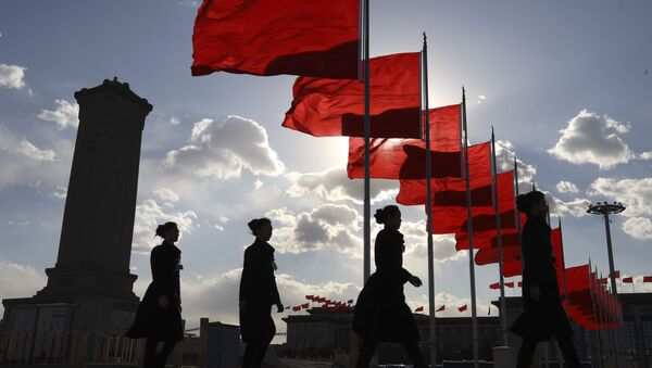 Bus ushers walk past red flags on Tiananmen Square during a plenary session of the Chinese People's Political Consultative Conference (CPPCC) at the Great Hall of the People in Beijing Monday, March 11, 2019 - Sputnik International