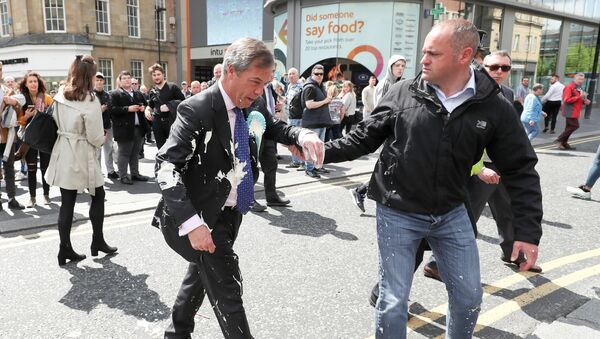 Brexit Party leader Nigel gestures after being hit with a milkshake while arriving for a Brexit Party campaign event in Newcastle, Britain, May 20, 2019 - Sputnik International