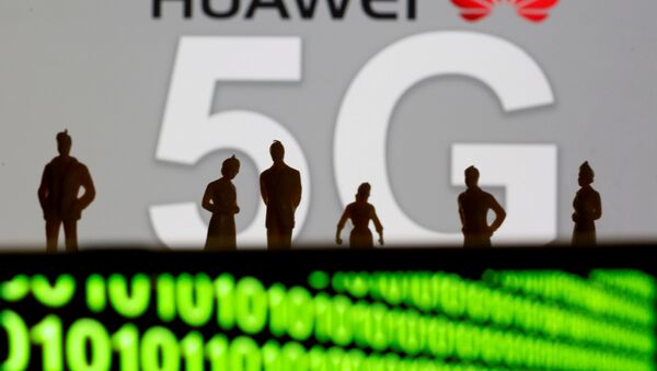 Small toy figures are seen in front of a displayed Huawei and 5G network logo in this illustration picture, March 30, 2019 - Sputnik International