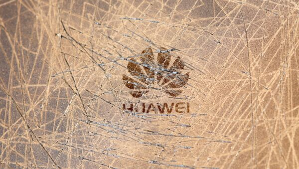A scratched surface Huawei logo is seen on a smarthphone in this illustration picture taken May 20, 2019 - Sputnik International