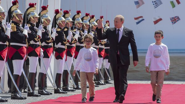 Russian President Vladimir Putin visiting Normandy, France, during the 70th anniversary of D-Day. June 2014. - Sputnik International