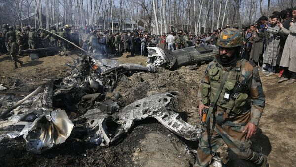 An Indian army soldier walks past the wreckage of an Indian helicopter after it crashed in Budgam area, outskirts of Srinagar, Indian controlled Kashmir, Wednesday, Feb.27, 2019 - Sputnik International