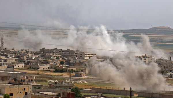 This picture taken on May 22, 2019 shows smoke plumes rising from the Syrian town of Khan Sheikhun in the southern countryside of the rebel-held Idlib province. - Sputnik International