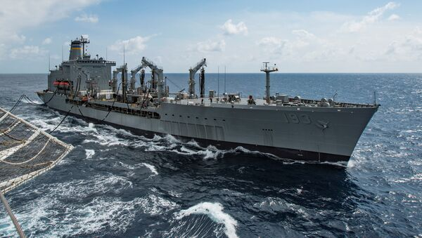 Military Sealift Command fleet replenishment oiler USNS Walter S. Diehl (T-AO 193) pulls alongside hospital ship USNS Mercy (T-AH 19) to deliver supplies and mail by a connected replenishment in the South China Sea August 15, 2016 - Sputnik International
