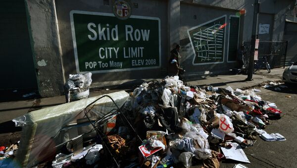 Trash lies beside the Skid Row City Limit mural as the city begins its annual homeless count in Los Angeles, California on January 26, 2018. - Sputnik International