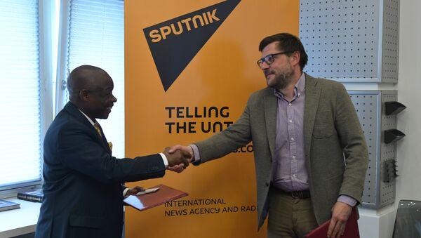 Sergei Kochetkov, Rossiya Segodnya First Deputy Editor-in-Chief, and Ernest Kabila Ilunga, Director General of RTNC. - Sputnik International